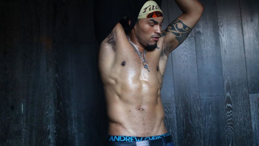 """Hunk-O-Mania male revue performer Nino Martinez, stage name """"Romeo Suave,"""" changes in a dressing roo"""