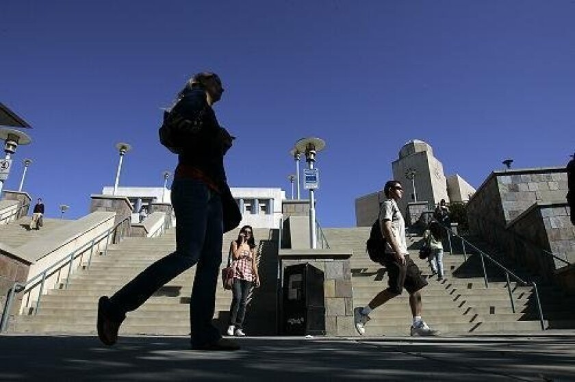 Students passed the main staircase at Cal State San Marcos. Last year the university accepted qualified students through March for fall admission, but now it cannot guarantee that anyone applying after Nov. 30 will get in.