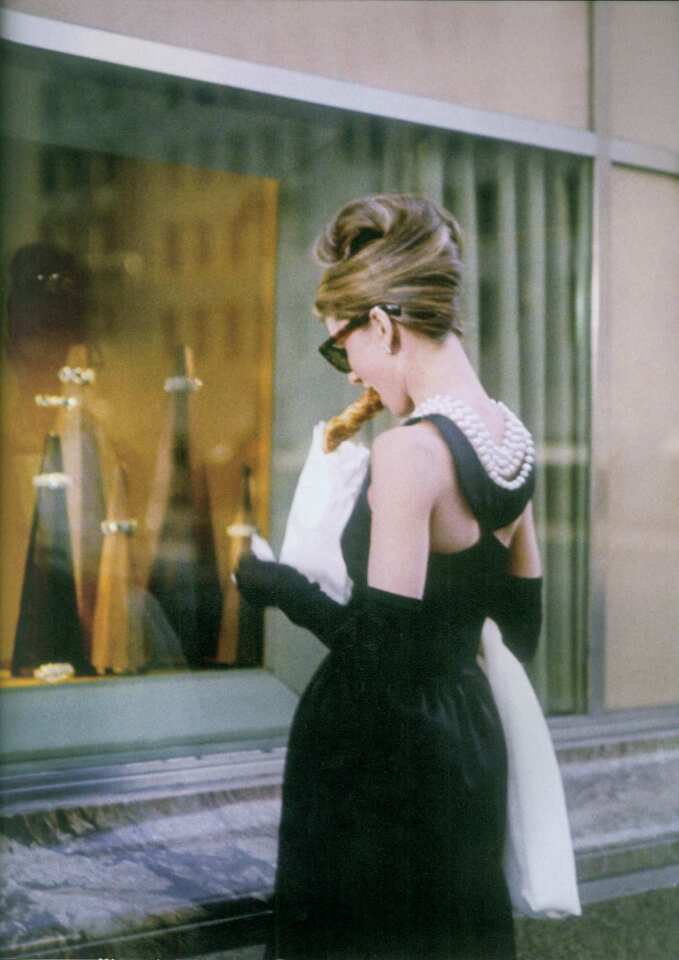 "Audrey Hepburn in the 1961 movie ""Breakfast at Tiffany's."" Her costumes were design by Herbert de Givenchy."