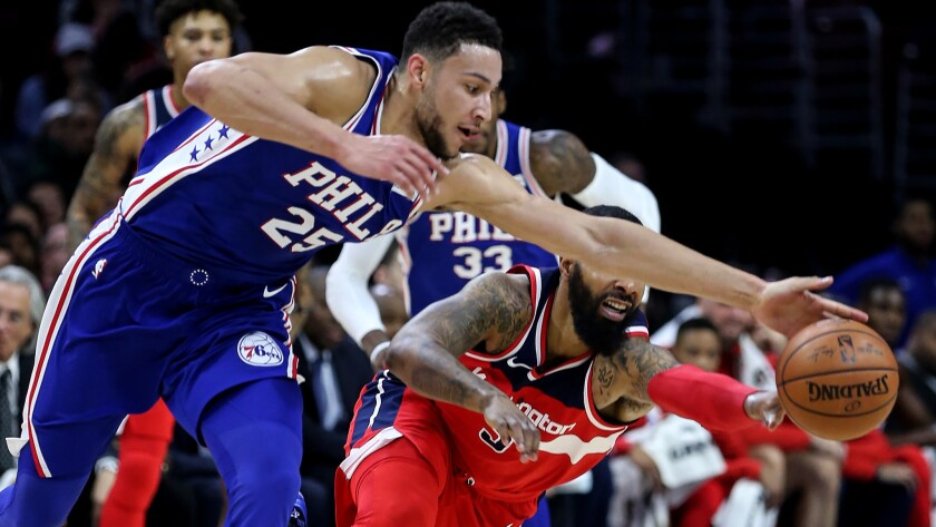 76ers forward Ben Simmons steals the ball from Wizards forward Markieff Morris during the second quarter Wednesday.