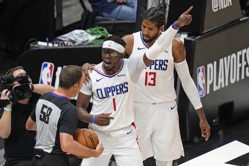 Los Angeles Clippers guard Reggie Jackson (1) argues with referee Josh Tiven (58) during the first half of Game 5 of the team's second-round NBA basketball playoff series against the Utah Jazz on Wednesday, June 16, 2021, in Salt Lake City. (AP Photo/Rick Bowmer)