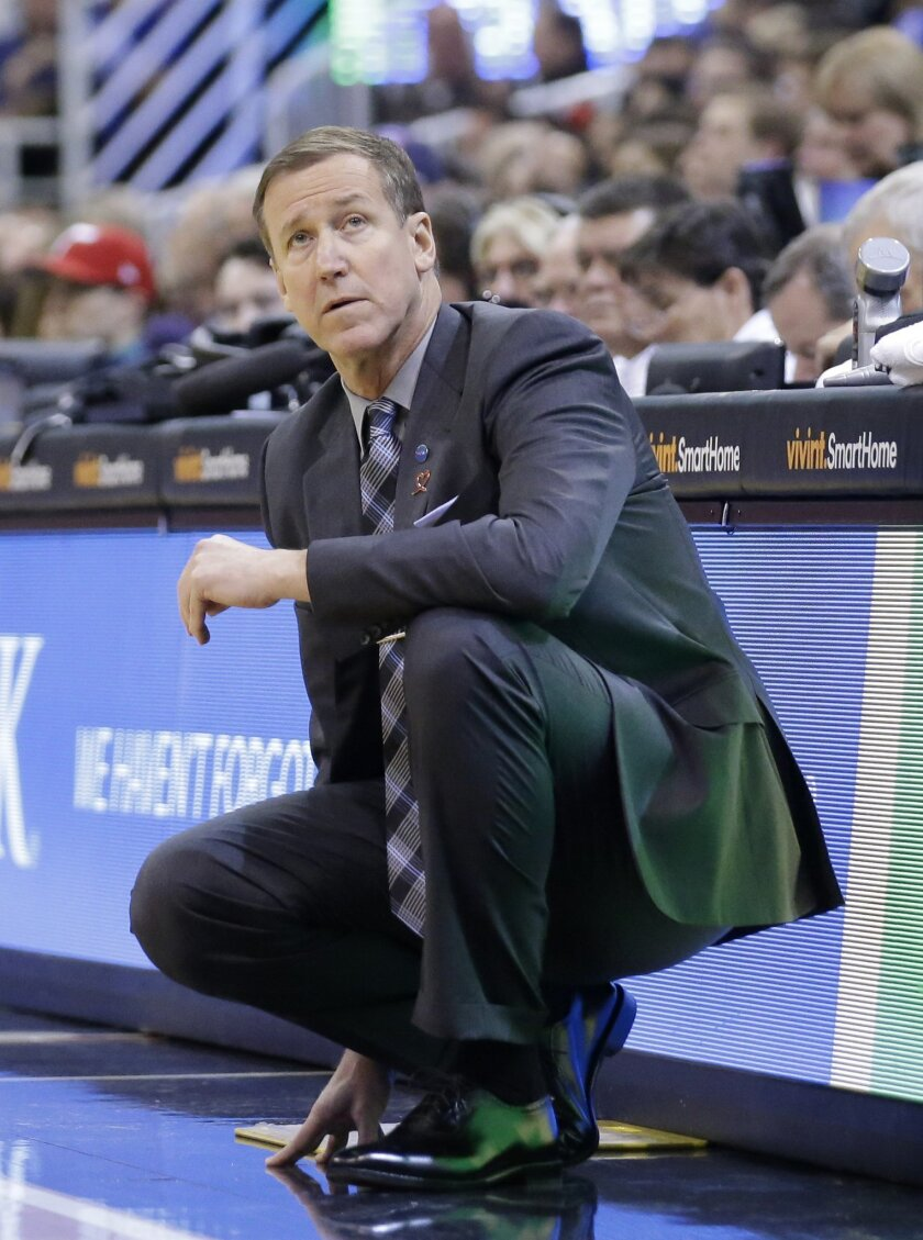 Portland Trail Blazers head coach Terry Stotts looks on in the second quarter during an NBA basketball game against the Utah Jazz Wednesday, Nov. 4, 2015, in Salt Lake City. (AP Photo/Rick Bowmer)