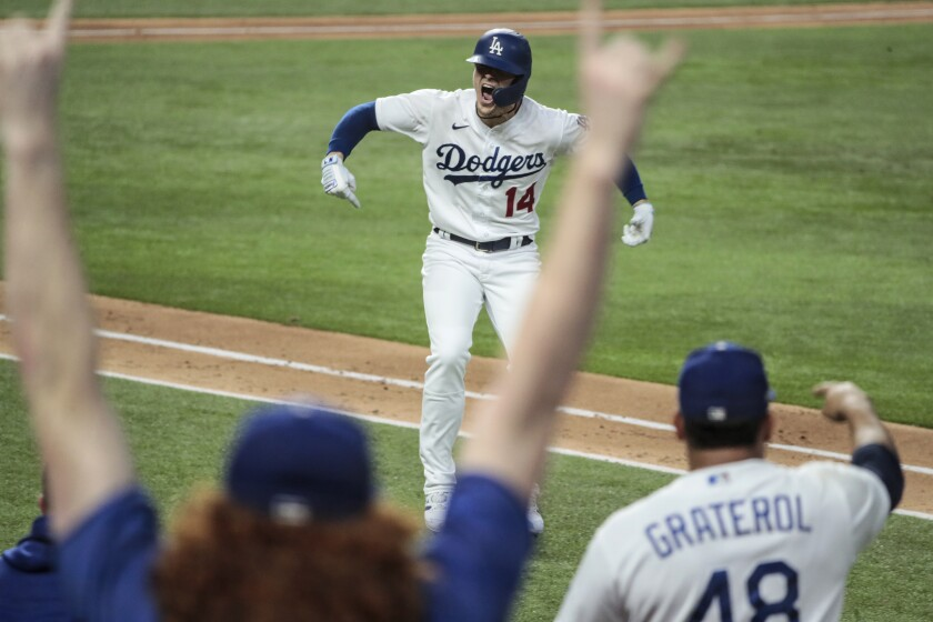 Dodgers pinch hitter Kiké Hernandez reacts after hitting a home run during the sixth inning in Game 7 of the NLCS.