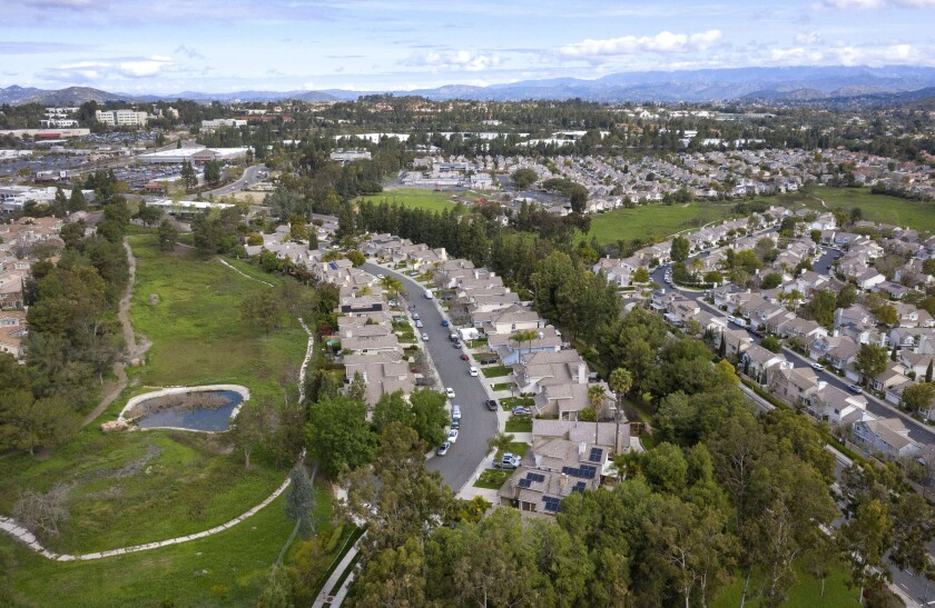 Aerial view looking north of fairways of the former Carmel Mountain Ranch Country Club golf course where homes are planned. The street in the middle is Eastbourne Road.