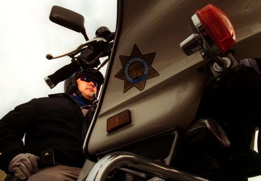 California Highway Patrol Officer Alvin Yamaguchi patrols the highways in Santa Ana.