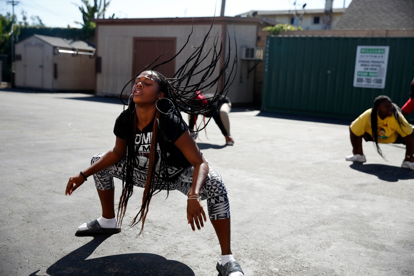LOS ANGELES, CA-AUGUST 26, 2019: Kamryn Johnson dances with classmates after school on August 26, 2019 in Los Angeles, California. She is a student at ICEF View Park Prep Charter High School, across the street from the Marathon store where Nipsey Hussle was shot and killed earlier this year. (Photo By Dania Maxwell / Los Angeles Times)