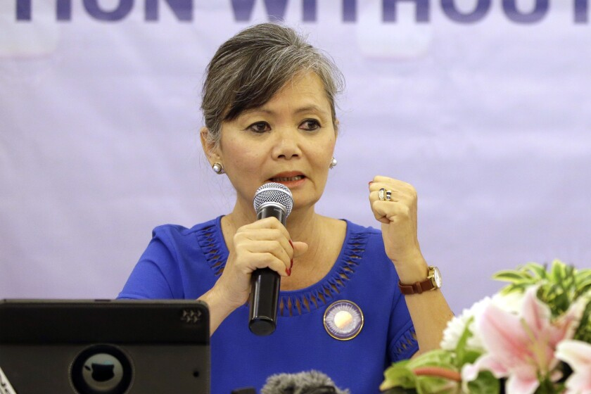 FILE - In this July 30, 2018, file photo, Vice President of the Cambodia National Rescue Party (CNRP), Mu Sochua speaks at a press conference in Jakarta, Indonesia. Senior executives of the disbanded opposition Cambodia National Rescue Party have announced their plan to return from self-imposed exile to fight criminal charges against them in court. (AP Photo/Tatan Syuflana, File)