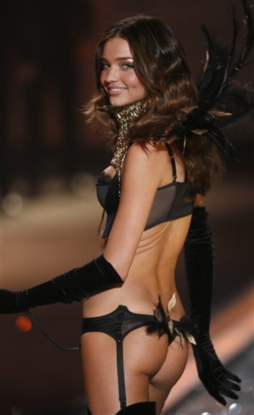 FILE -- In a Thursday, Nov. 19, 2009 file photo Miranda Kerr walks the runway during the Victoria's Secret Fashion Show at the Lexington Armory in New York.Miranda Kerr says an Australian banker left red-faced when a live TV broadcast showed him looking at her scantily clad photos at work shouldn't be fired. (AP Photo/Jason DeCrow/file)