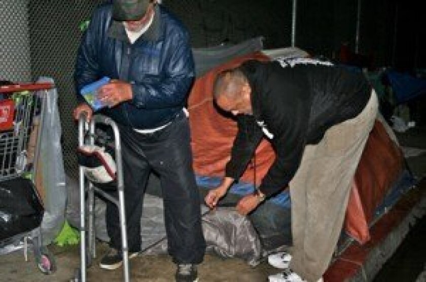 Two or three times a month, based entirely on available donations, SDVFP members head out after dark to areas in downtown San Diego known to be popular sleeping spots for the homeless, and hand out about sleeping bag sets.