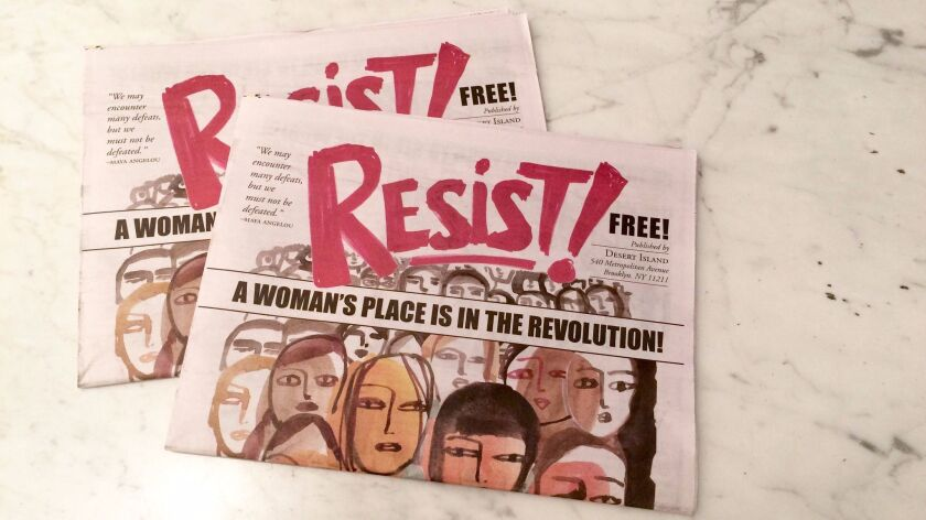 "Copies of the women's art comic ""Resist!"" at the Hammer Museum."