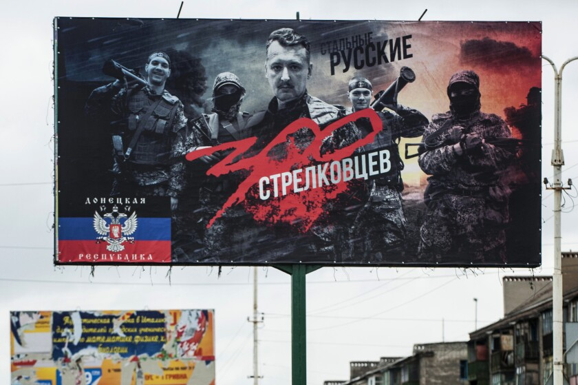 "A portrait of Igor Strelkov, the Russian special forces officer commanding pro-Russia separatists in the proclaimed ""People's Republic of Donetsk"" in eastern Ukraine. The billboard hailing ""300 Strelkovists,"" a play on the 1962 film ""300 Spartans,"" appeared Thursday in Konstantynivka."
