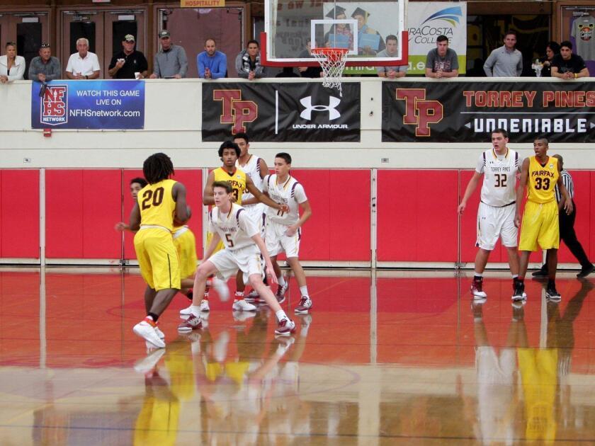 TPHS player Finn Sullivan (#5) guards the Fairfax basket
