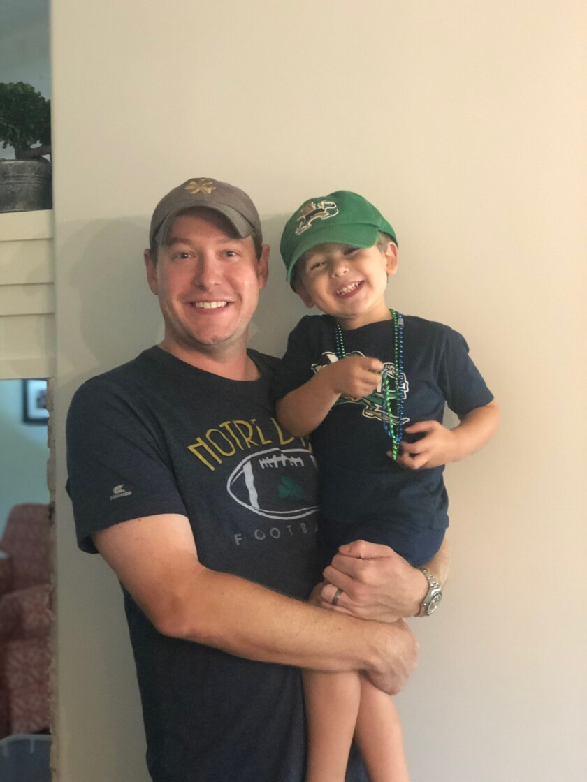 Chris Zeches, 34, with son Francis, 3. Zeches is a Notre Dame graduate living in Phoenix.