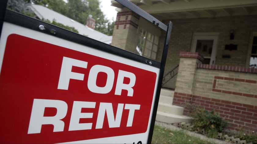 """A self-described busybody has opinions about rental property. Above, a """"for rent"""" sign outside a home."""
