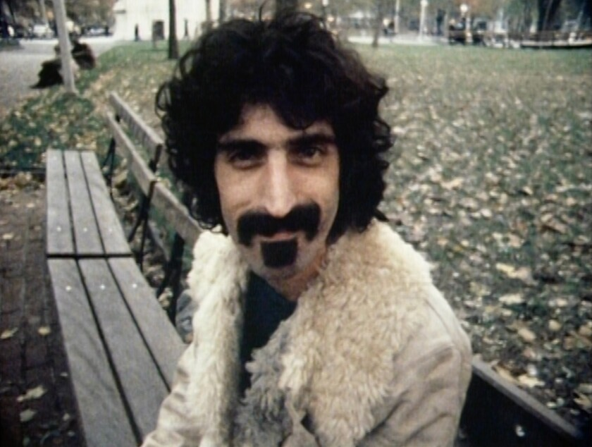 """Frank Zappa on a park bench in the documentary """"Zappa."""""""