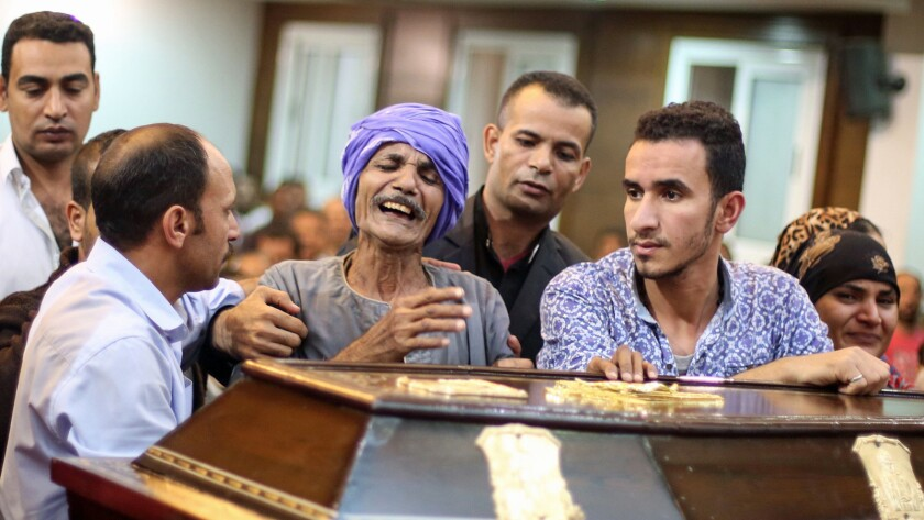 Relatives and friends of Christian Assad Labib, 35, mourn at his funeral at the Anglican Church in Sawaada village near Minya after the Islamic State ambush.