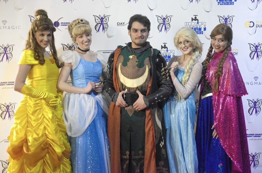 Princesses and a Medieval Times knight pose on the red carpet as they attend Talent for Epilepsy's second annual talent and fashion show on Saturday evening at the Courtyard Irvine Spectrum hotel. Proceeds from ticket sales will be donated to people struggling with epilepsy-related expenses.
