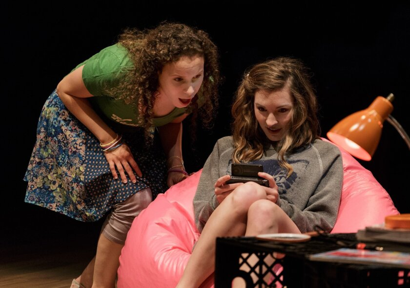 Katie (Cristina Gerla-left) watches as Crystal (Kate Sapper) seeks info on her cell phone in 'Kingdom City.'