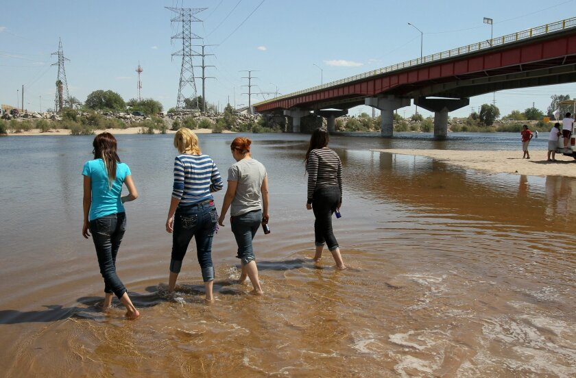 A group of young women enjoy the recently arrived Colorado River water here near the large Mexican Highway 2 bridge in San Luis Rio Colorado. Photo by Charlie Neuman