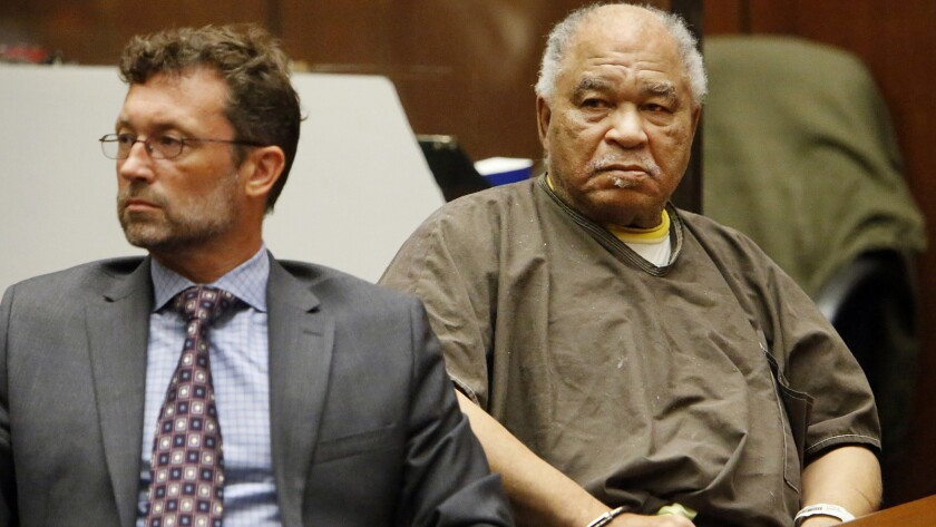 Samuel Little, right, and Deputy Public Defender Michael Pentz listen to victims' statements at a September 2015 hearing in Los Angeles.