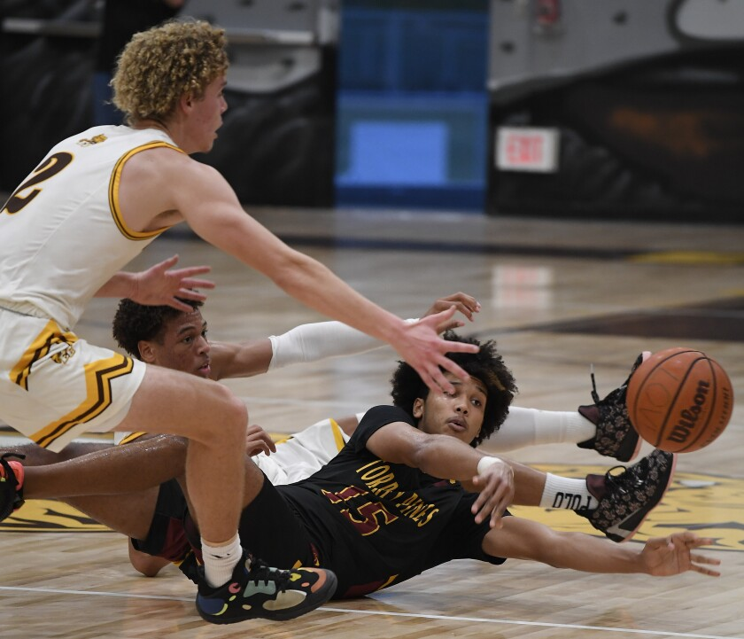 Torrey Pines' Chris Howell passes off in front of El Camino's Henry Hartwell.