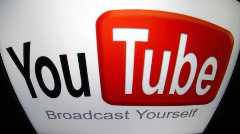 The YouTube logo is seen on a tablet screen on Dec. 4, 2012 in Paris.