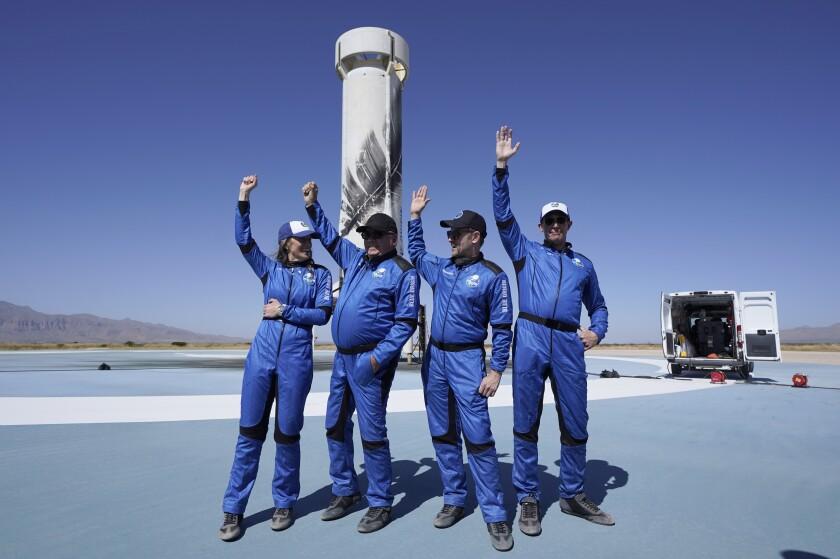 Parachutes slow the descent of the Blue Origin capsule