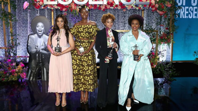 Honorees Regina Hall, left, KiKi Layne, Amandla Stenberg and Jenifer Lewis attend the 2019 Essence Black Women in Hollywood Awards luncheon at the Regent Beverly Wilshire Hotel on Feb. 21 in Los Angeles.