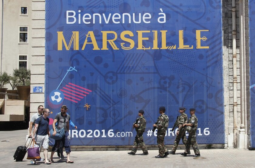 French soldiers on patrol in downtown Marseille, southern France, a day before the world champion takes on the host nation in the European Championship's second semifinal , Wednesday, July 6, 2016. France will face Germany in a Euro 2016 semifinal soccer match in Marseille on Thursday, July 7, 2016