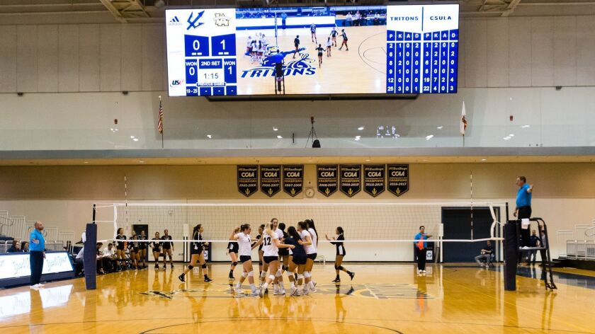 UCSD women's volleyball, playing below the new video board, was the first to stage athletic events at the renovated RIMAC Arena