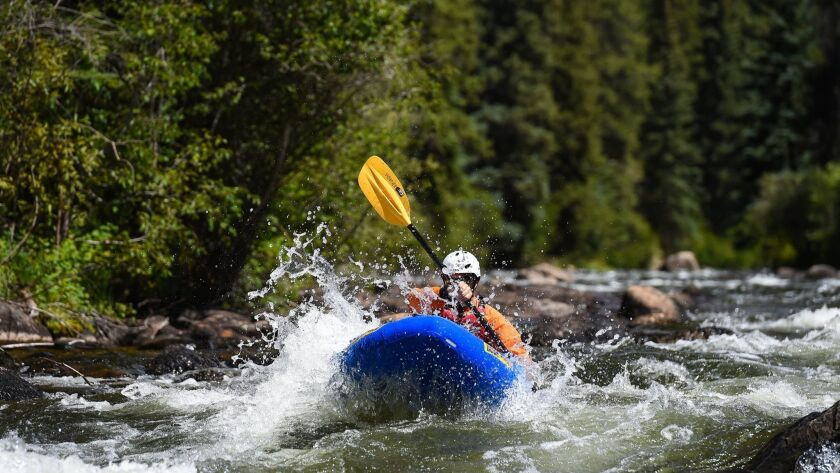 Kayaking the rapids of Gunnison River.