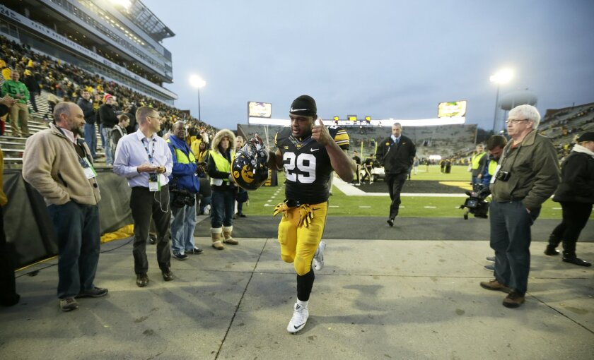 Iowa running back LeShun Daniels Jr. runs off the field after his team's 31-15 victory over Maryland in an NCAA college football game, Saturday, Oct. 31, 2015, in Iowa City, Iowa. (AP Photo/Charlie Neibergall)