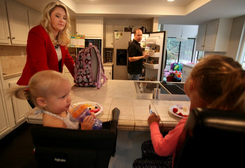 Danielle and Jeremy Moore prepare breakfast for their children, 5-year-old Ireland and 1½-year-old Winter in their Carlsbad home.