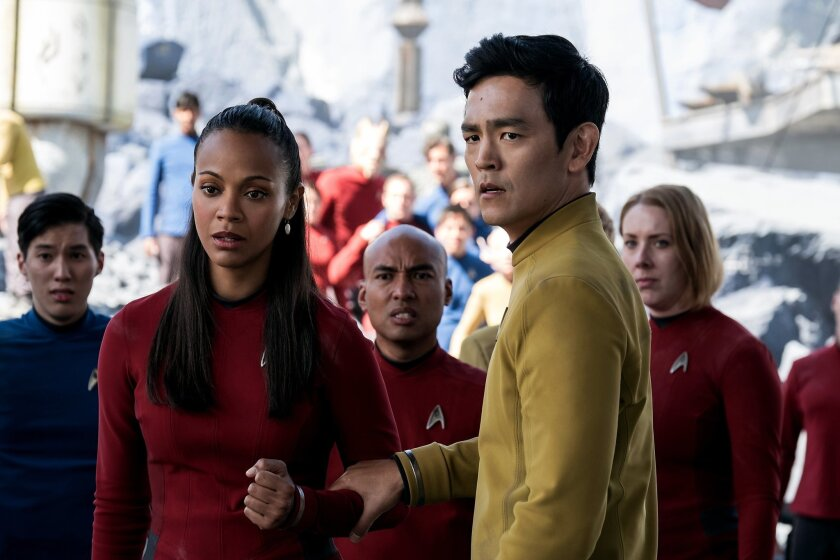 "In this image released by Paramount Pictures, Zoe Saldana, left, as Uhura and John Cho as Sulu appear in a scene from, ""Star Trek Beyond."" The movie releases in the U.S. on July 22, 2016. (Kimberley French/Paramount Pictures via AP)"