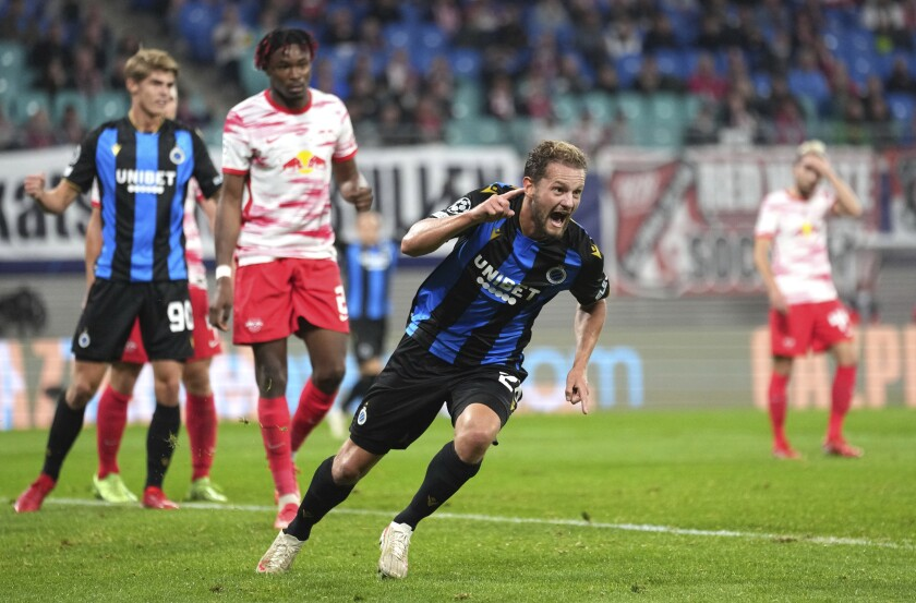 Brugge's Mats Rits, center, celebrates after scoring his sides second goal during the Group A Champion's League soccer match between RB Leipzig and Club Brugge at the Red Bull Arena in Leipzig, Germany, Tuesday, Sept. 28, 2021. (AP Photo/Michael Sohn)