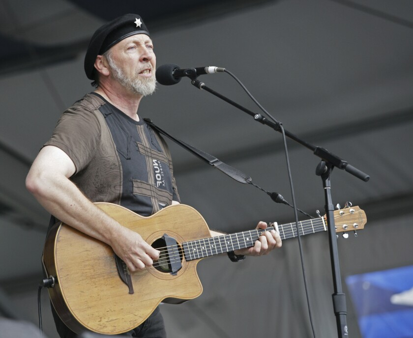 """FILE - Richard Thompson performs during the 2008 New Orleans Jazz & Heritage Festival at the New Orleans Fairgrounds Racetrack in New Orleans, on May 2, 2008. Thompson's book """"Beeswing: Losing My Way and Finding My Voice 1967–1975"""" released on April 6. (AP Photo/Dave Martin, File)"""