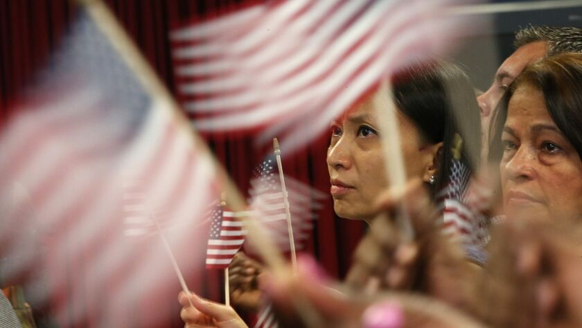 New U.S. citizens participate in a naturalization ceremony in New York on Aug. 23, 2013.