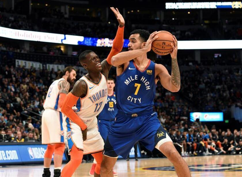 Denver Nuggets forward Trey Lyles (R) is guarded by Oklahoma City Thunder guard Dennis Schroder during the first quarter of an NBA game at the Pepsi Center in Denver on Dec. 14, 2018. EPA-EFE/Todd Pierson