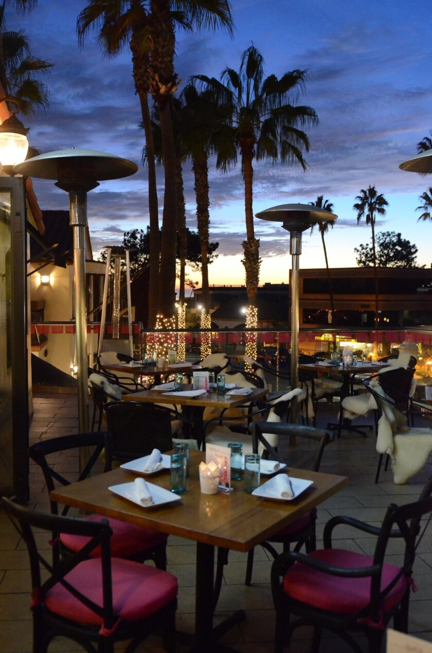 Twilight on the patio, which overlooks Prospect Street.