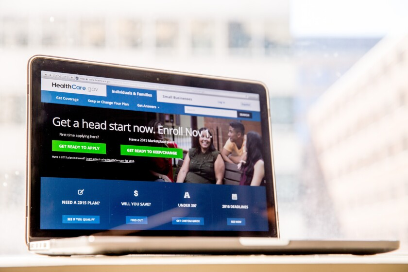 The HealthCare.gov website, where people can buy health insurance, is displayed on a laptop in Washington.