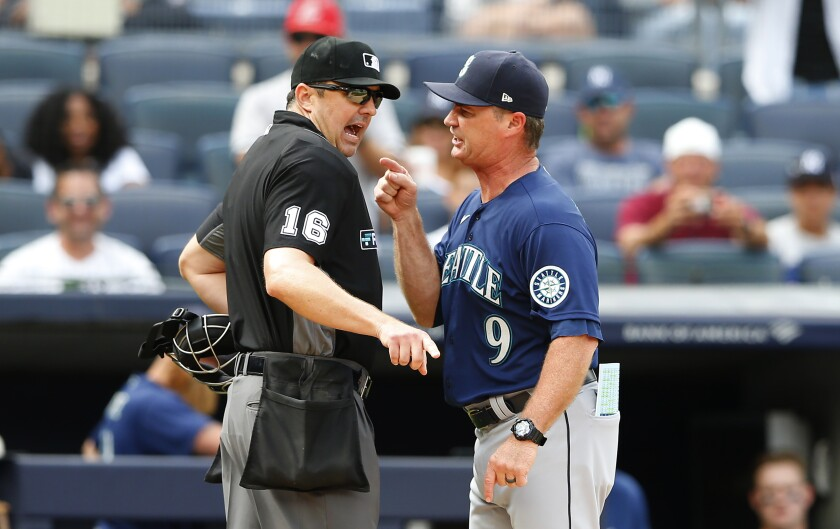 Seattle Mariners manager Scott Servais (9) argues with umpire Lance Barrett (16) before being ejected during the eighth inning of a baseball game against the New York Yankees, Sunday, Aug. 8, 2021, in New York. (AP Photo/Noah K. Murray)