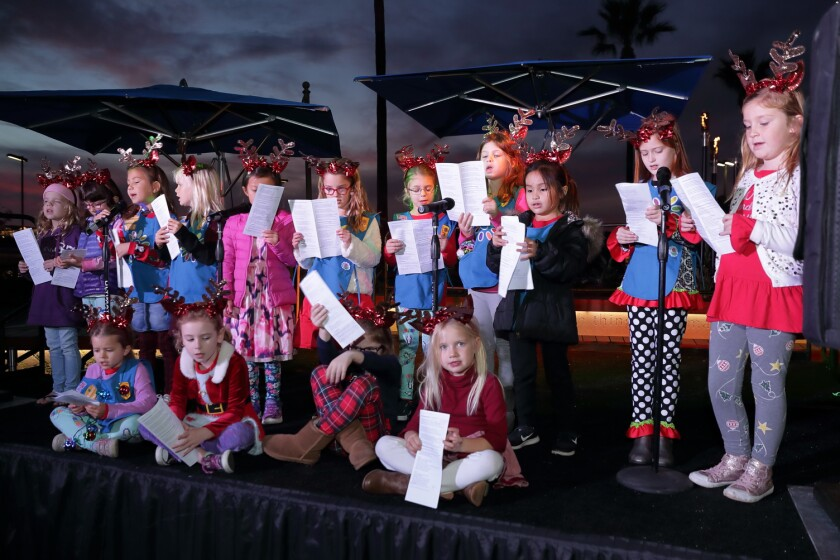 Girl Scouts from Carmel Creek School sang holiday songs