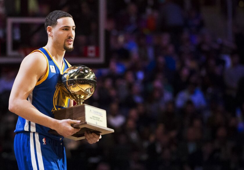 Golden State Warriors guard Klay Thompson (11) receives his trophy after winning the three point competition during the NBA all-star skills competition in Toronto on Saturday, Feb. 13, 2016. (Mark Blinch/The Canadian Press via AP) MANDATORY CREDIT