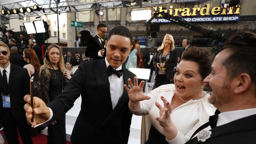 HOLLYWOOD, ?CA ? February 24, 2019 Trevor Noah with Melissa McCarthy and husband Ben Falcone durin
