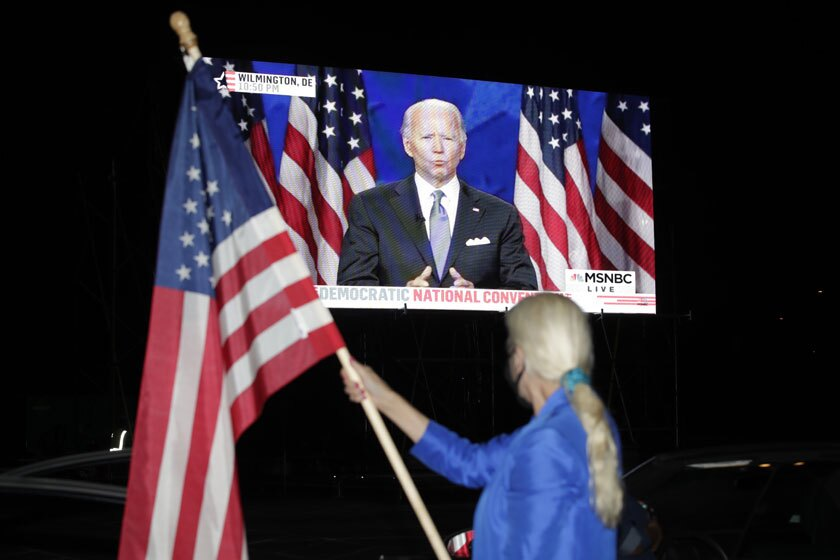 Presidential nominee Joe Biden's convention speech is broadcast at a drive-in theater watch party Thursday in Washington.