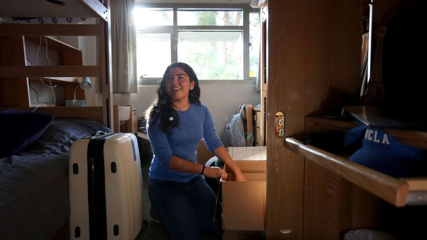 WESTWOOD, CA: September 22, 2017 - Desiree Felix, age 18, unpacks her dorm room in Hendrick Hall at