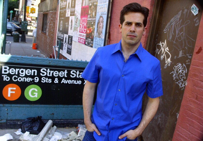 Author Jonathan Lethem poses for a photograph in his Brooklyn neighborhood in New York, July 15, 200
