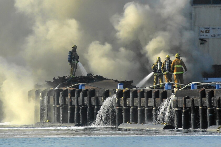 Los Angeles fire crews battle a fire at the Port of L.A. that burned lumber soaked in creosote, releasing toxic chemicals into the air.