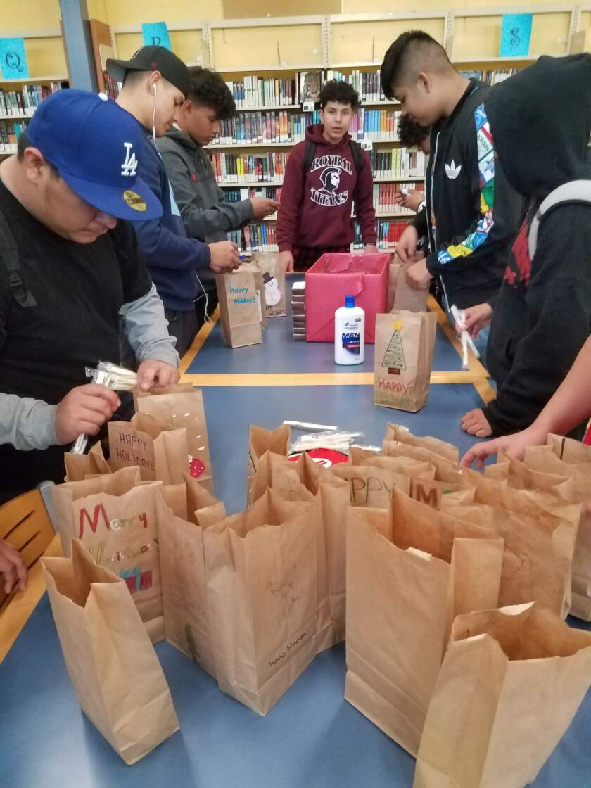 Roybal High football players helped put together more than 150 hygiene kits