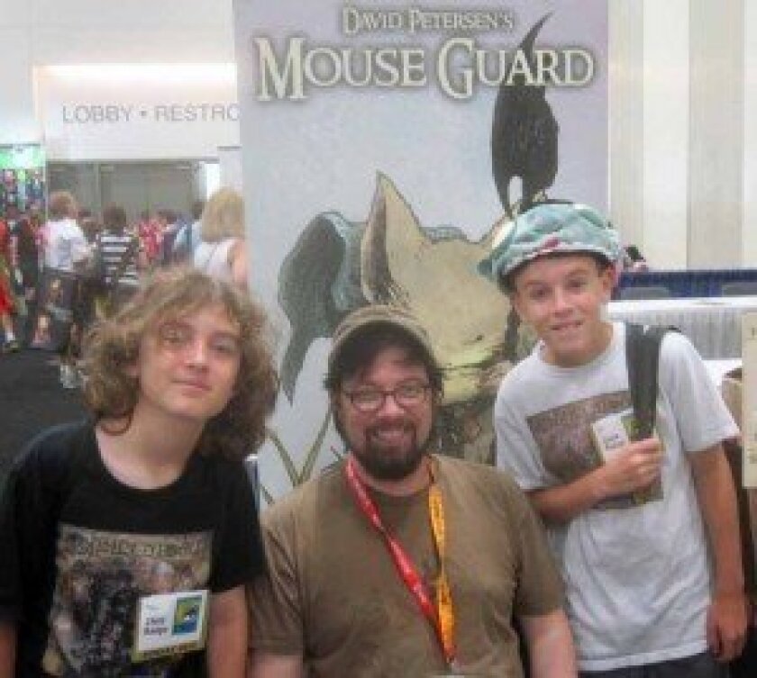 Josh and Harrison Herz with Mouse Guard author/illustrator David Petersen.